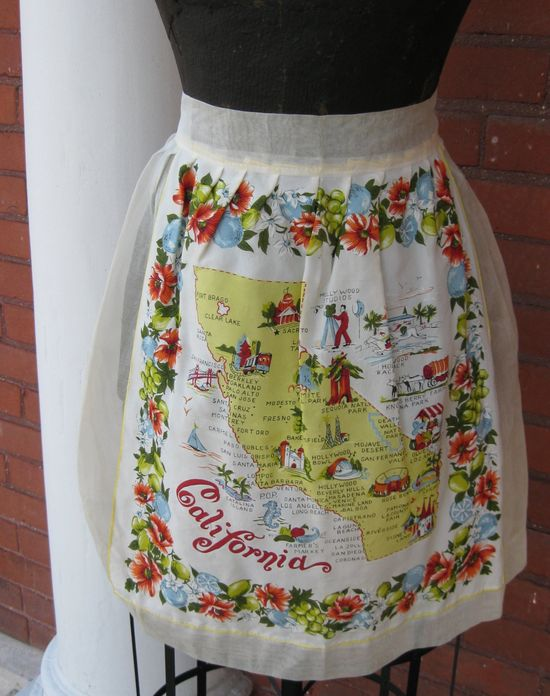 Vintage linen linens, ie tea towels, calendars used in aprons