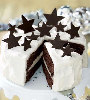 White Chocolate Truffle and Chocolate Fudge Layer Cake with Homemade Chocolate Stars. Fabulous for helping to ring in the New Year! #cake #chocolate #baking #dessert #New_Years #party #celebration #birthday #stars