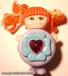 Does anyone remember the name of this toy? It is driving me crazy! It is a little compact that the feet, hands, and head fold into//I can't believe I forgot about this!!!  I had one and I loved it!