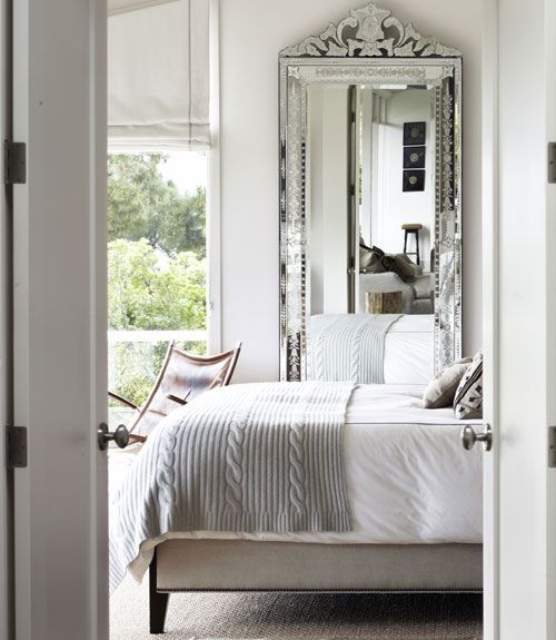 Pretty grey and white bedroom with garden walk-out!