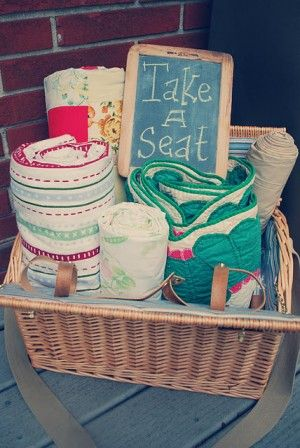 Cute basket with blankets for a backyard cookout