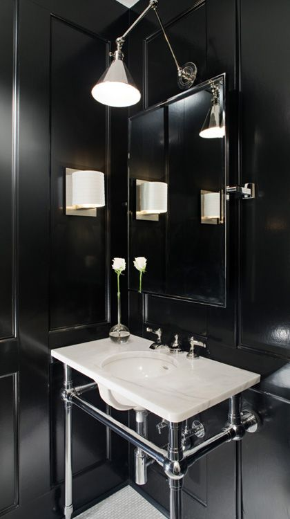 dark walls and sink suspended with chrome
