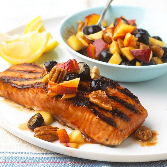 Fresh fruit salsa balances out the spicy barbecue sauce on this Salmon. More cookouts that dazzle: www.bhg.com/...