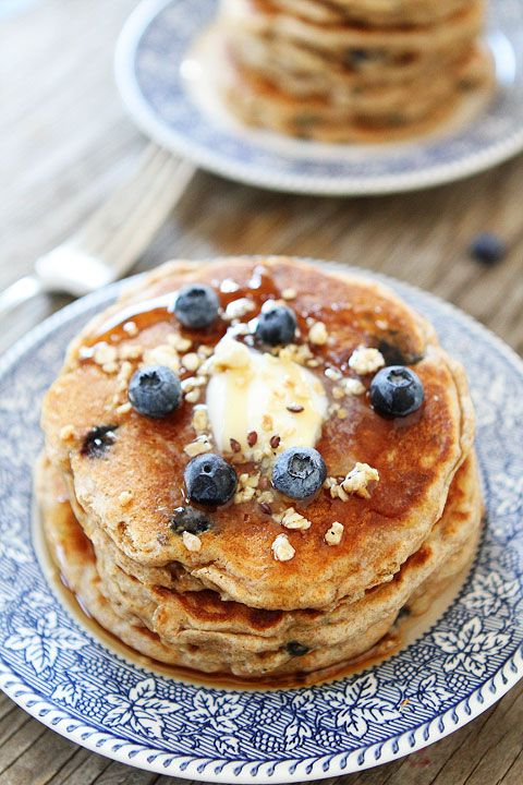 Whole Wheat Blueberry Granola Pancake Recipe from twopeasandtheirpo... Our family loves these pancakes!