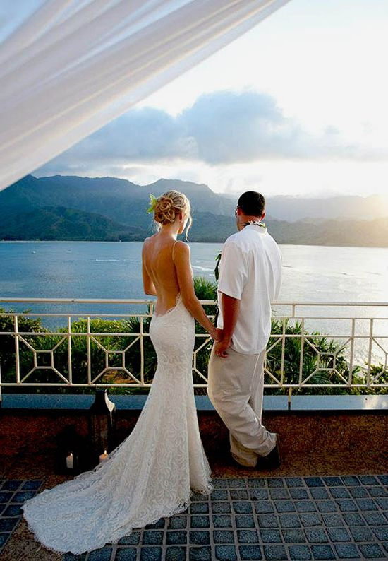 So romantic! love her backless gown!