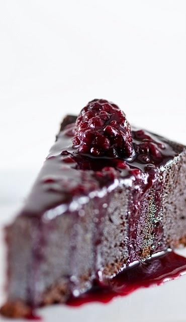 Chocolate orbit cake with blackberry-cassis sauce. #food #chocolate #cake #dessert