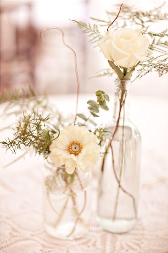 Wedding details. Photographed by Caroline Ghetes, on Style Me Pretty. #stylemepretty #caroline_ghetes #vintage_bottles #roses #wedding_flowers