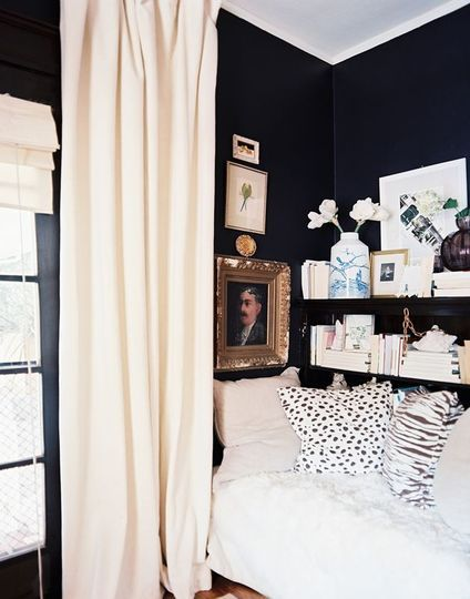 Dark walls. White accents. Small bedroom.