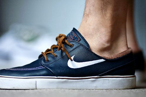 A cross between Nike tennis shoes and maybe a boat shoe or something?