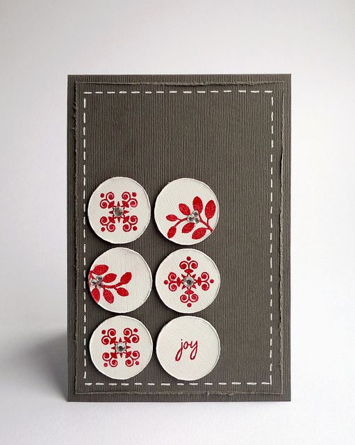 handmade card: joy by ..::aga  ... like the white circles with red stamping on the dark gray card ... faux stitching makes me feel this is folklore inspired ... but there are gems on each of the stamped images !!