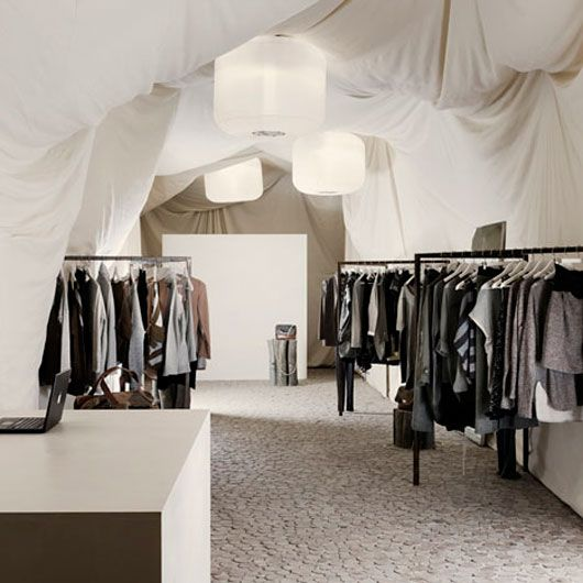 contrasting floor and fabric draped walls/ceilings