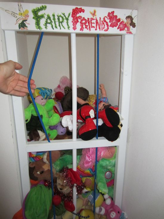 Storage for stuffed animals.Flexible bars for easy grabbing.Great idea!