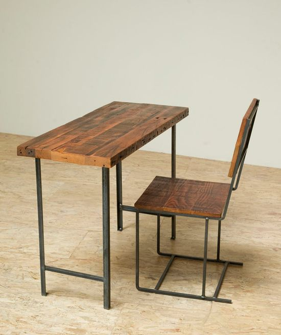 Reclaimed wood and iron desk and chair.