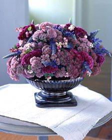Like a tapestry, this bouquet is a celebration of rich hues and textures. Round Sedum 'Autumn Joy' and fuzzy fuchsia Celosia argentea var. cristata provide fullness, while snowberries and blue Salvia 'Indigo Spires' function as accents.