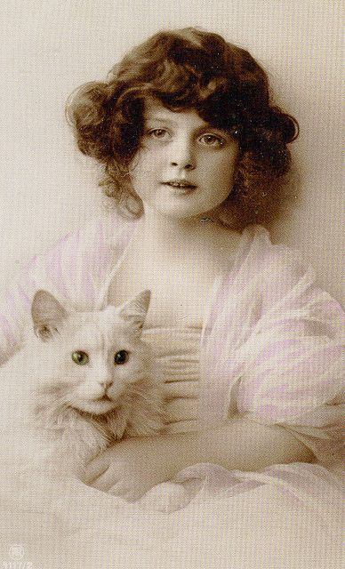 Little girl with a white cat