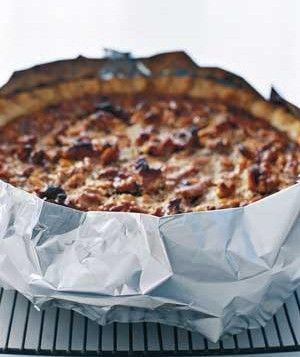 Prevent pie crusts from burning by protecting them with aluminum foil.