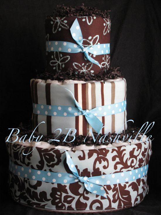 super cute diaper cake!...can use a set of 3 receiving blankets to wrap each tier in!...and i LOVE the brown/chocolate scrunchie paper between the layers!!