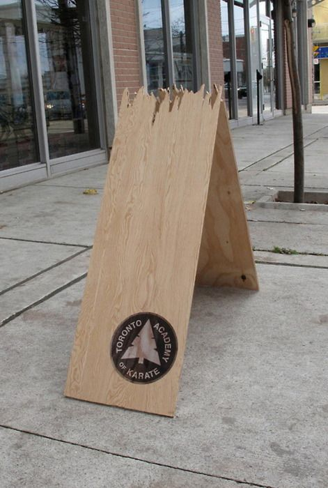 broken sandwich board ad for a Toronto karate academy - genius!  from • A Smile in the Mind