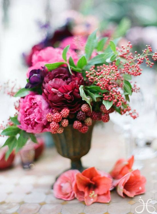 Combo of flowers + fruit in floral arrangements.