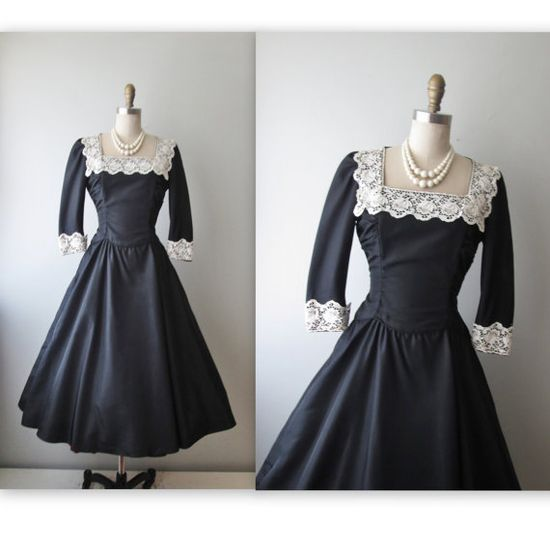 Don't you think this navy 1950s dress has a vaguely Victorian air about it? #1950s #dress