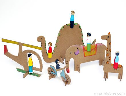 Peg dollies riding cardboard animals and vehicles