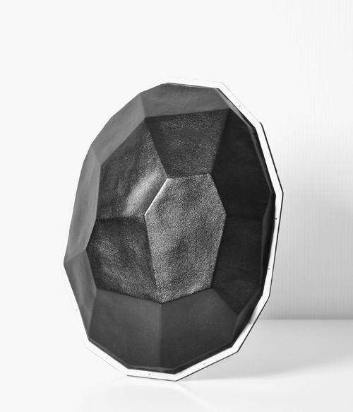 Sanna Svedestedt  Brooch: Black Diamond 2009  Naturally tanned reindeer skin, titanium, silver  http://www.svede.se/