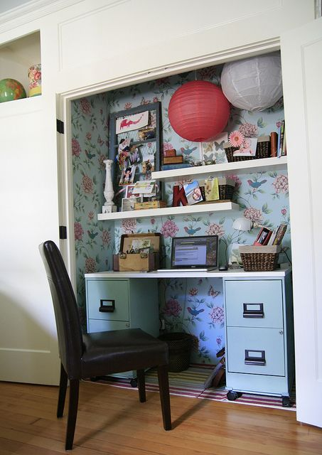 This is like you cubby where your desk is. I love the pop of a color or wall paper then the shelves then you could put his moms picture up like they have here.