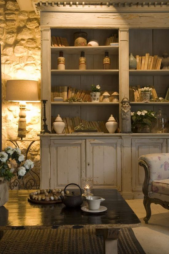 stone wall and bookcases