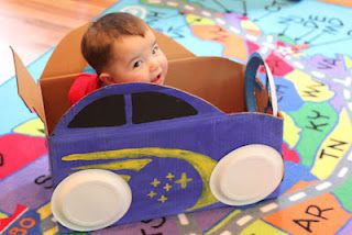 Make a toddler car out of a diaper cardboard box