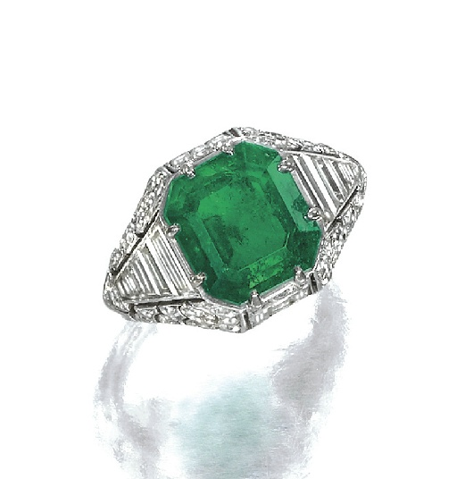 EMERALD? AND? DIAMOND? RING,? 1930S      Set? with? a? step-cut? emerald,? the? shoulders? and? bezel? decorated? with? tapered? baguette? and? single-cut? diamonds,? mounted? in? platinum,   numbered,? French? assay? marks.