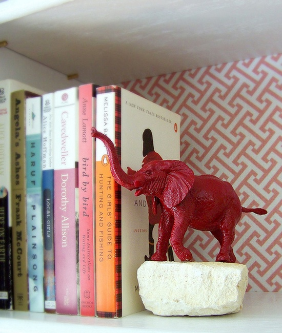 DIY bookends (spray paint plastic figurines, glue to rocks)