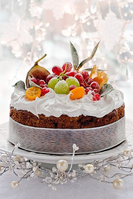 A terrifically elegant, beautifully festive Christmas cake topped with sugared fresh fruit. #cake #food #dessert #decorated #Christmas #baking #elegant #holidays