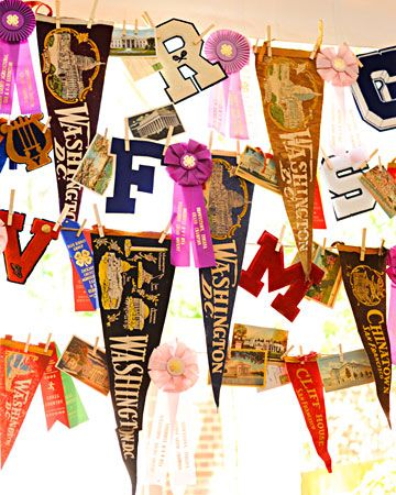 Vintage pennants and varsity letters decorate a reception tent