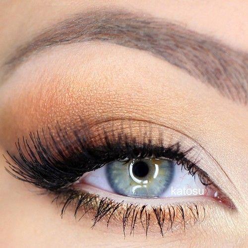 Orange gold eye makeup .