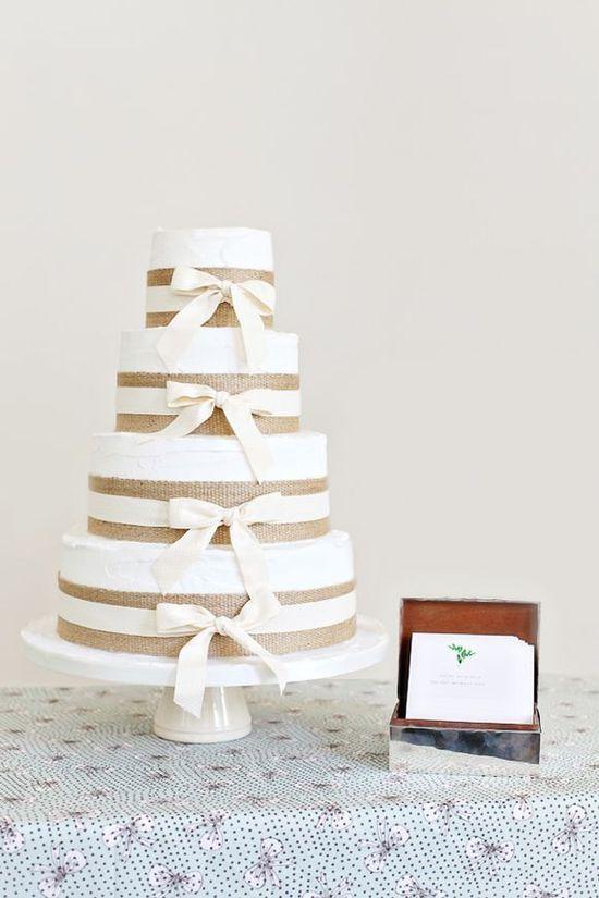Rustic burlap-wrapped wedding cake #weddings #weddingcake