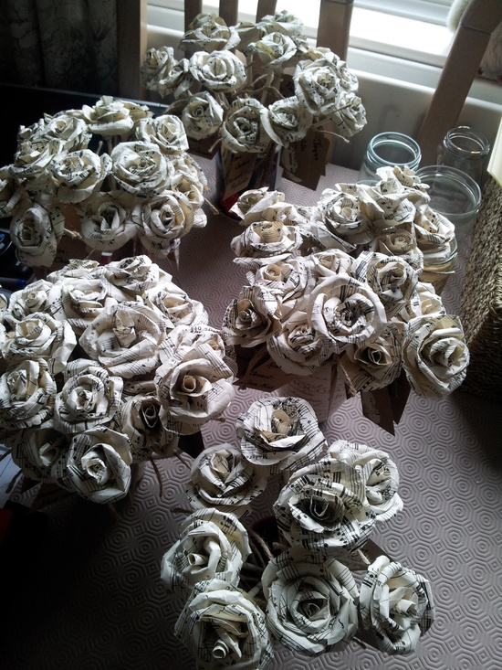 Handmade music paper roses for place names.... several hours of hard work!