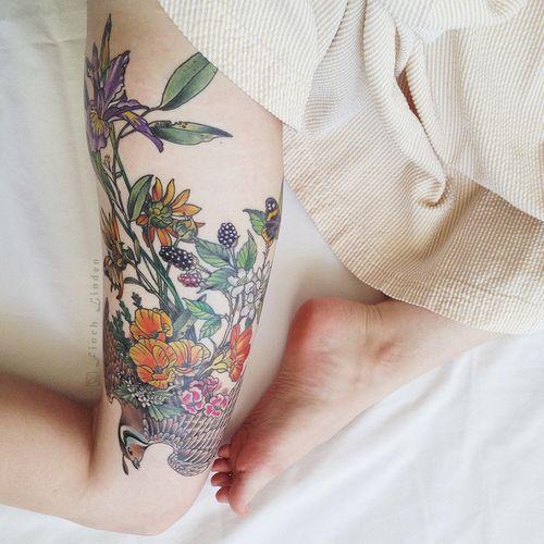 Floral thigh/leg tattoo.