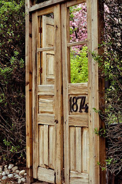 creative entrance to a beautiful garden.