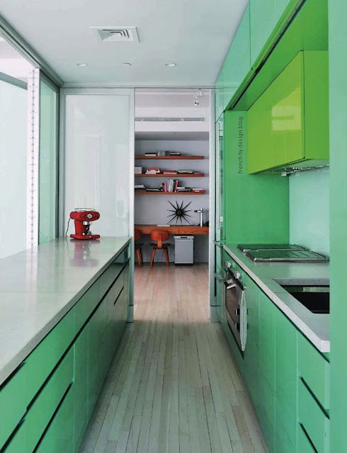 green kitchen with orange accessories