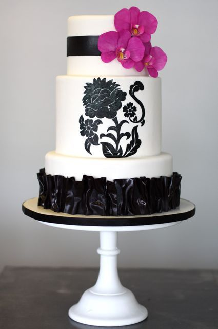 Black & white wedding cake with hot pink orchids.