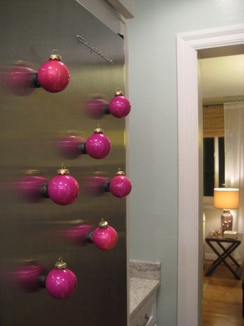 glue magnets to ornaments for a fun way to decorate your fridge during Christmas....love it!!