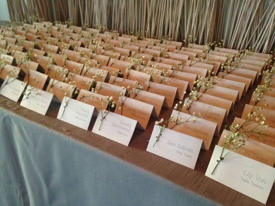 Bridal Bliss Wedding: cute babies breath on these escort cards