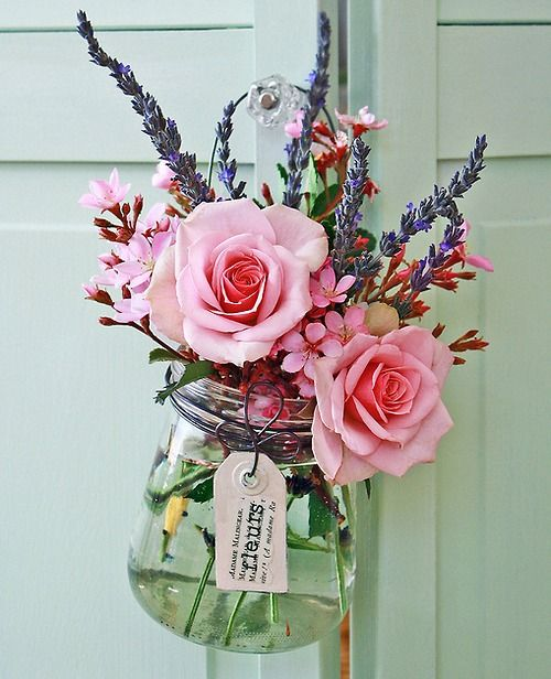 pretty flowers in jars as a gift. i love the idea of dropping these off on someone's door just to make their day brighter!