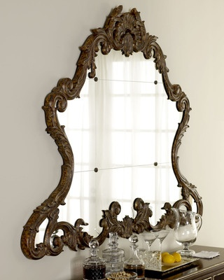 This mirror would make a great dramatic focal point. Buy it here: www.bhg.com/...
