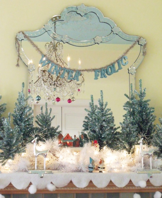 winter mantel You can see this mantel a bit better here hookedonhouses.ne... I love the snowball garland at the bottom