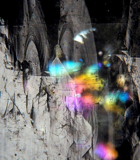 """Apophyllite Rainbows...    """"Internal fractures making rainbows deep within a clear apophyllite crystal , with reflections of patterns on the crystal's surface as well...""""  by Sea Moon on flickr"""