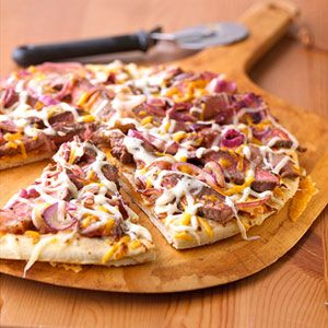 Seasoned steak, two kinds of cheese and sauteed onions. Winning ingredients for a sandwich, but wait until you try them in this quick and easy pizza recipe!