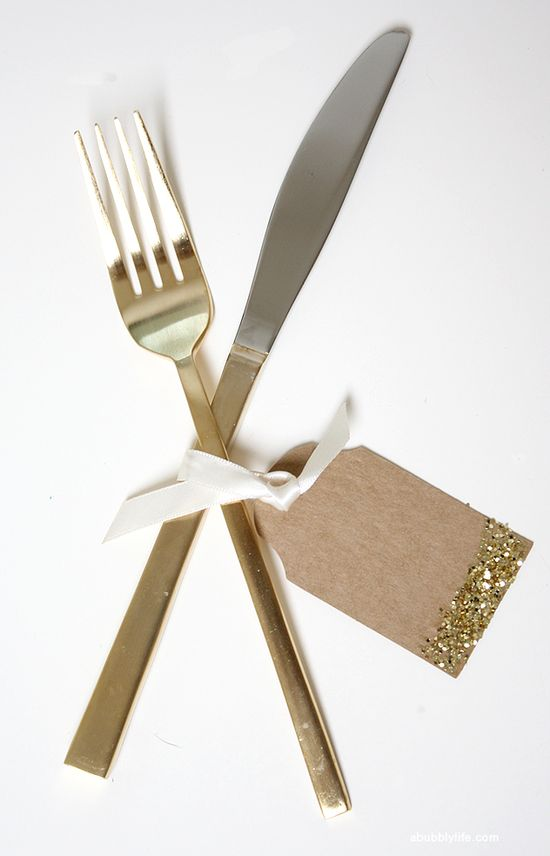 Gold cutlery and glittery name tags for fancy dinners.