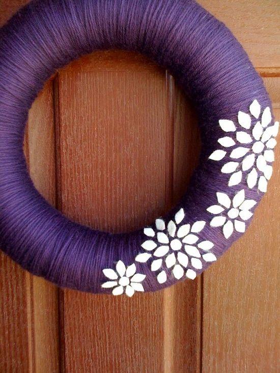 Yarn Wreath with felt flowers. Cute.