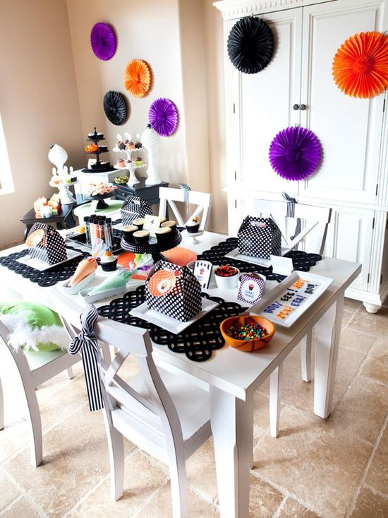 Throw a Halloween Cupcake-Decorating Party: Black and orange party decor is easy to find around Halloween; throw in a few punches of purple and lime for a playful twist on the traditional palette.